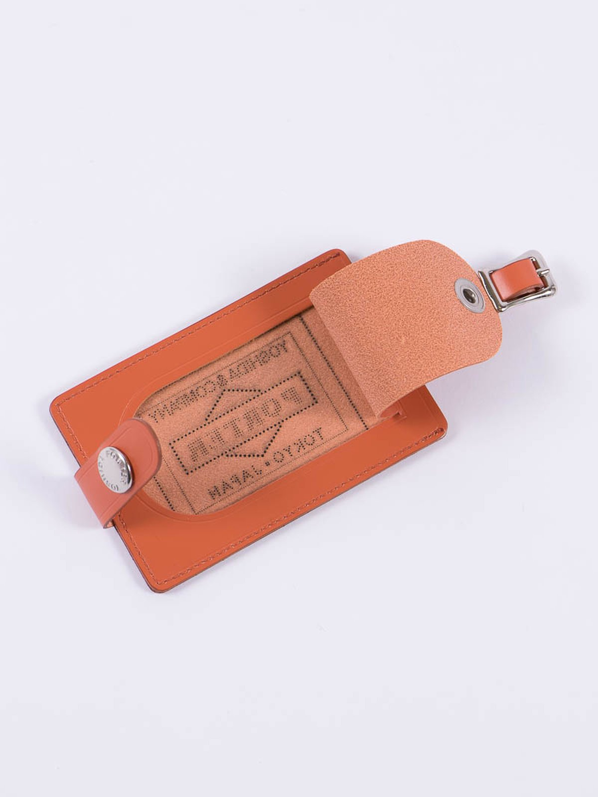Orange leather shop original luggage tag by porter for Bureau belfast